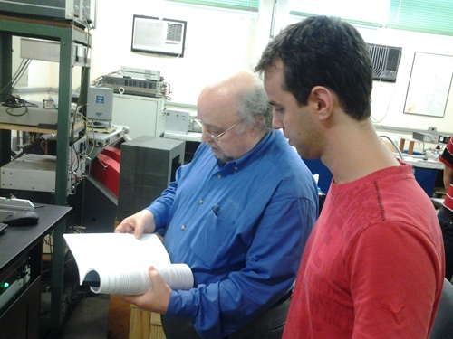 Jeff and a University student review the VSM manual.