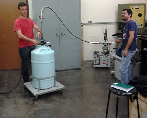 Post-doctoral students, Eduardo R de Lascio and Hardeep Kumar perform the first liquid helium transfer for the new Lake Shore VSM.